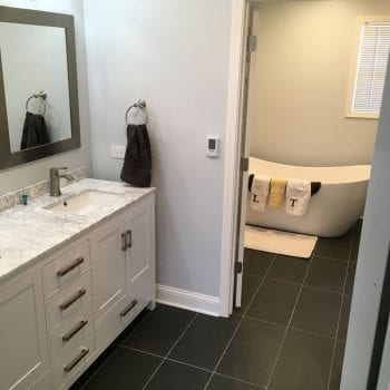 Bathroom remodeling in Schaumburg IL, new flooring, tiles, tub installation, and granite countertops