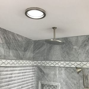 Master bathroom remodeling in Hoffman Estates - new natural stone tile and lighting