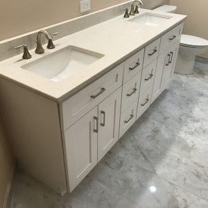 Bathroom remodeling in Hoffman Estates -new natural stone tile, cabinets, sinks