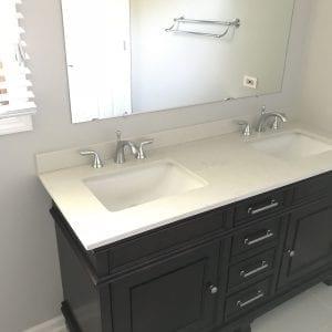 Bathroom remodeling in Schaumburg - new cabinets, sink, mirror, flooring