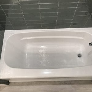 new tub and bathroom tile