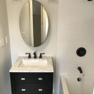 new bathroom sink and cabinets and antique decor