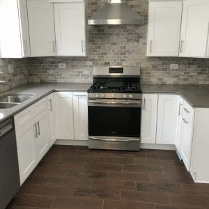 Modern kitchen remodeling, stone backsplash, stone tile flooring countertops, new kitchen cabinets