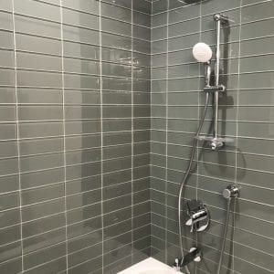new shower and tub, new shelving and tile