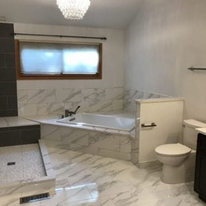 Bathroom Renovation in Schaumburg IL, new tub, tiles shower, tile flooring and bathroom cabinets