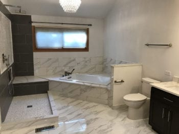 Bathroom Renovation in Chicago, new tub, tiles shower, tile flooring and bathroom cabinets
