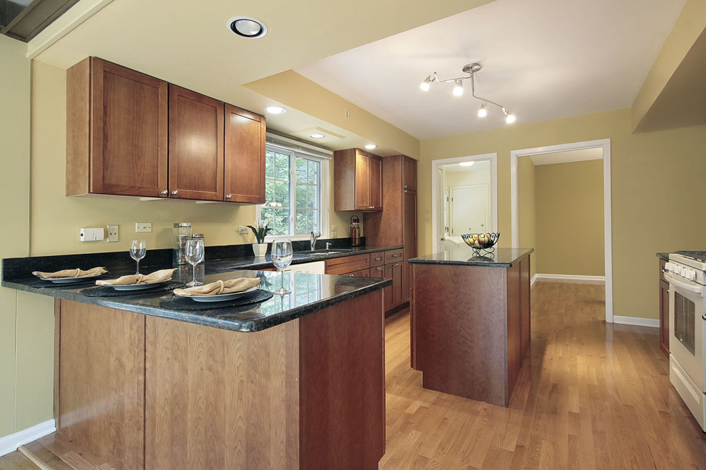 Kitchen in remodeled home with granite counters