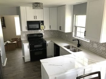 Kitchen Remodeling in Streamwood - black and white color palette, hardwood flooring