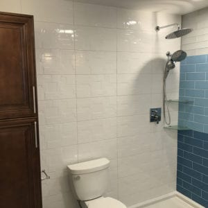 Remodeled bathroom cabinets, tile, and shower in Schaumburg IL