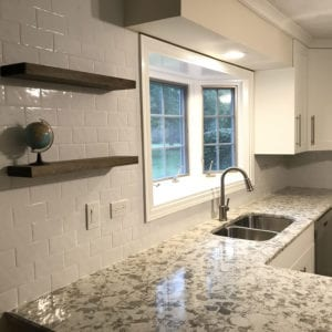 Kitchen remodeled in ElkGroev Village, IL, new natural stonecountertops