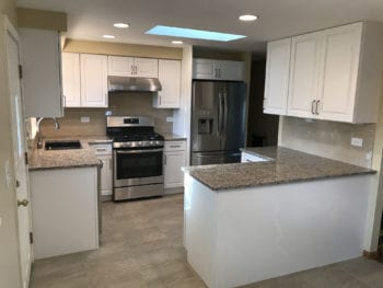 Kitchen cabinets, new flooring, and granite countertops in East Dundee