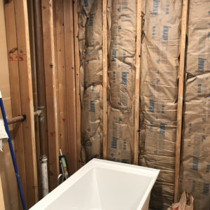 Bathroom wall being torn apart for bathroom remodel