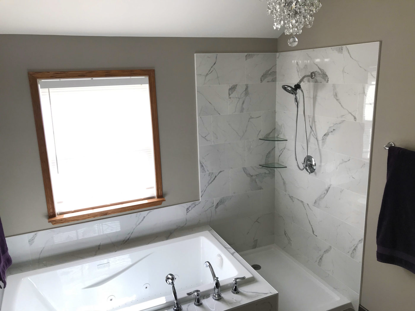 Bathroom Remodeling in Bartlett Illinois: a renovated bathroom with new tub, faucets, cabinets, countertop and more.