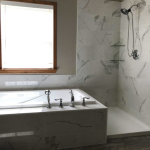 Bathroom Remodeling in Bartlett Illinois: a renovated bathroom with new tub, faucets, cabinets, countertops.